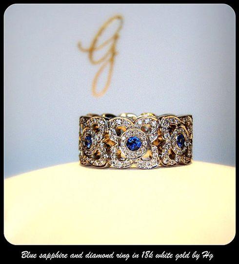 18k diamond and sapphire wedding band.  Gem quality sapphires and VS/G Russian cut diamonds.