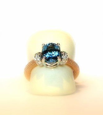 Non traditional 18k yellow and white gold engagement ring with a gem quality aquamarine and fine...