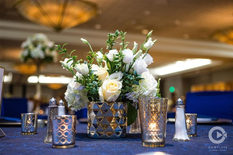 Cream roses and blue table cloth