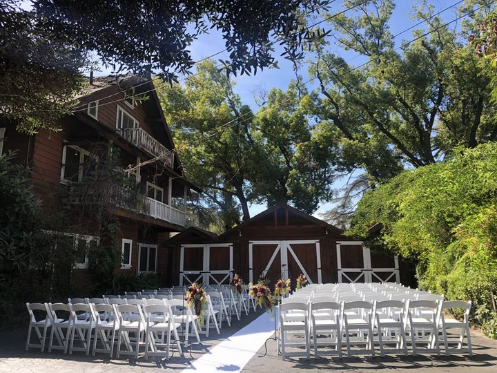 Ceremony area with barn backdrop