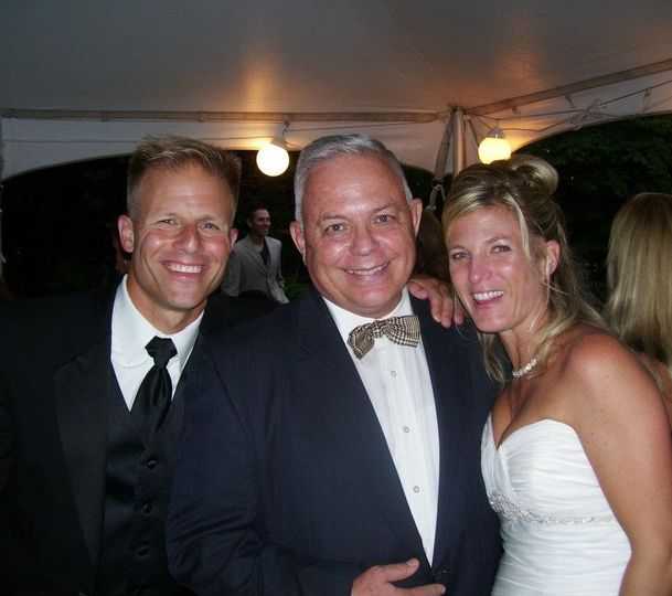 Husband and wife with the officiant
