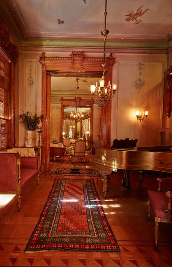 The open floor plan on the first floor of the museum allows visitors to view the music room, drawing...