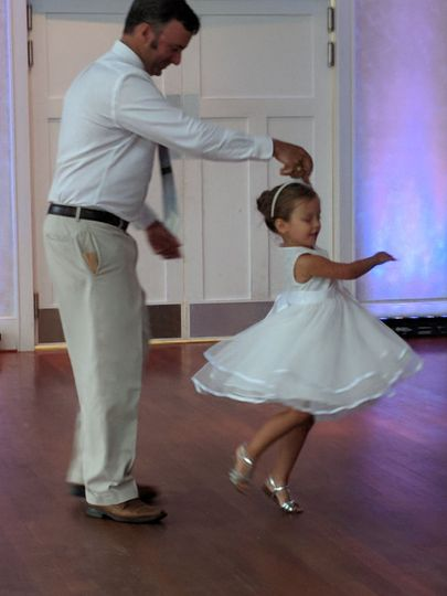 Kid dancing with the groom