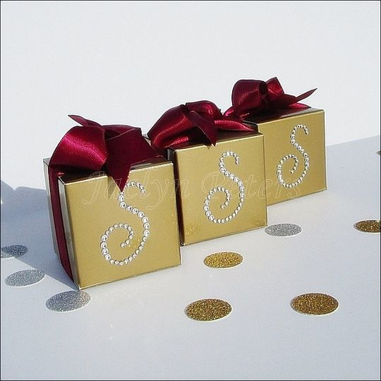 Trendy gold favor boxes accented with your choice of rhinestone initial and ribbon color to match...