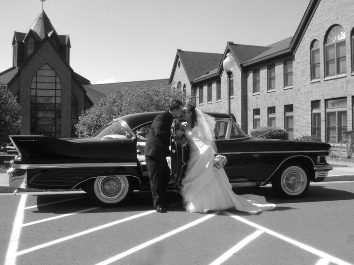 Elegance...a walk down the aisle and into the back seat of a 1958 Cadillac.