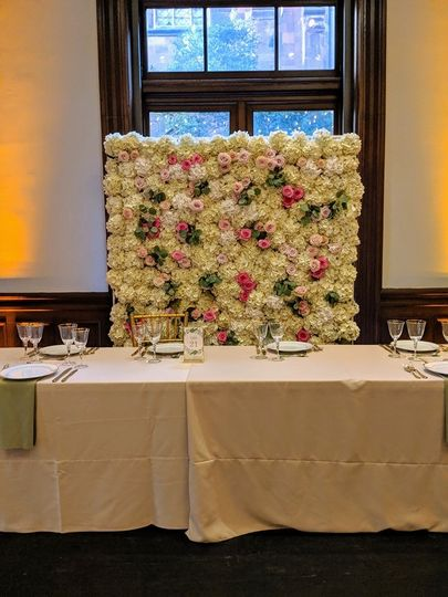 Flower wall accented with rose