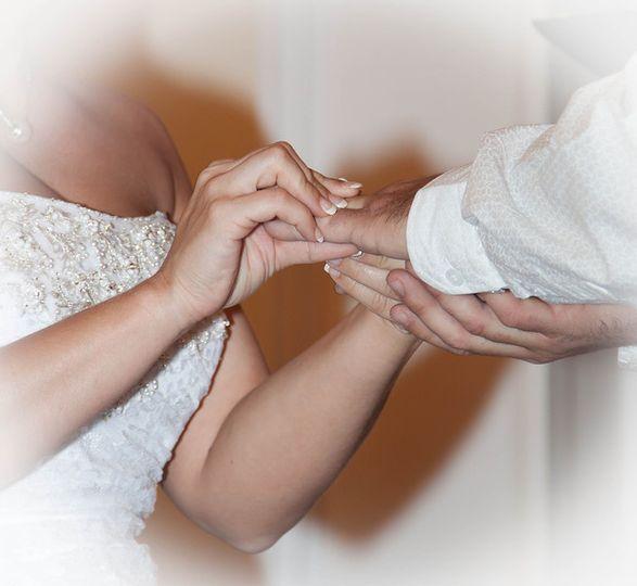 Couple exchanging ring