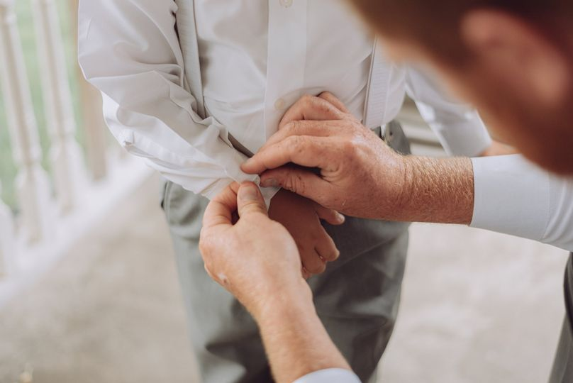 Groom helping ring bearer