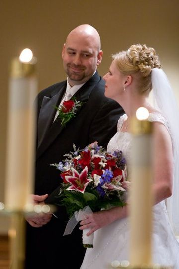 Beautiful framing of the couple during the ceremony.  I love capturing the little glances and...