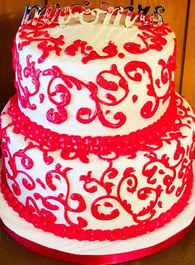Red and white scrolls cake