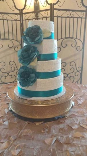 4-tier wedding cake with blue flowers and details
