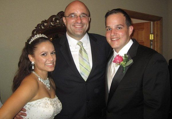 The officiant with the newlyweds