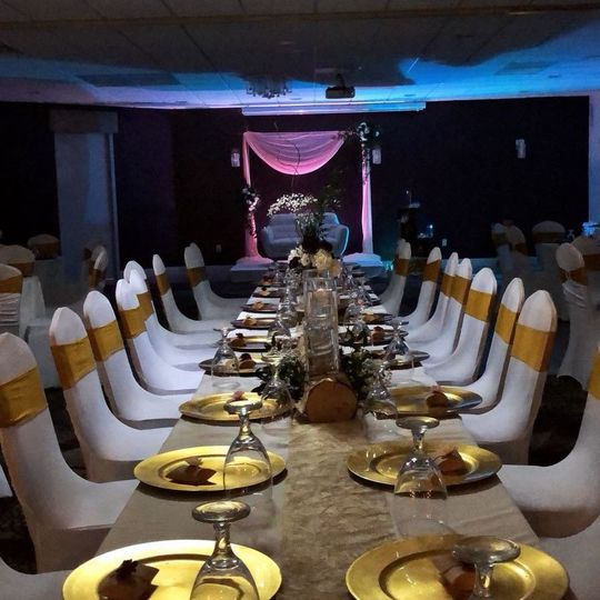Long reception table setup with gold decor