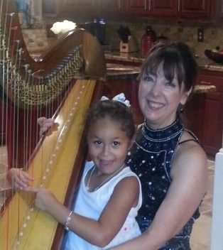 This little girl wants to learn harp!