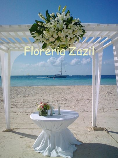 Beach weddingGazebo decorCancun wedding flowers