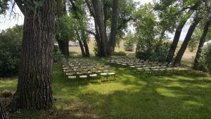 Outdoor wedding setup by the trees