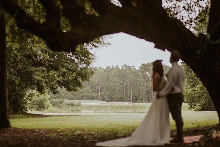Hidden under large oak trees