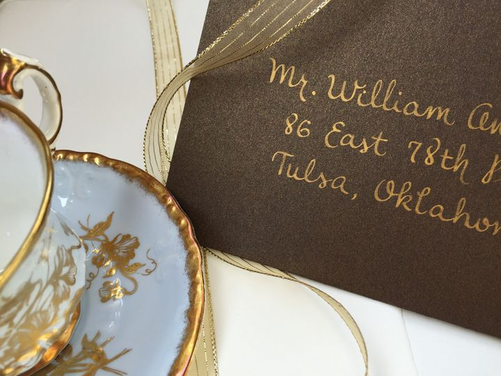 Brown envelope with gold ink
