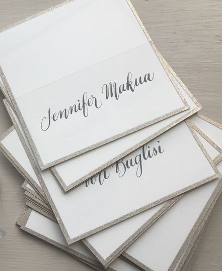 Place cards in modern calligraphy pointed pen.