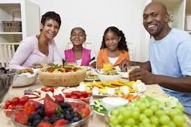 black family w fruits and veggies