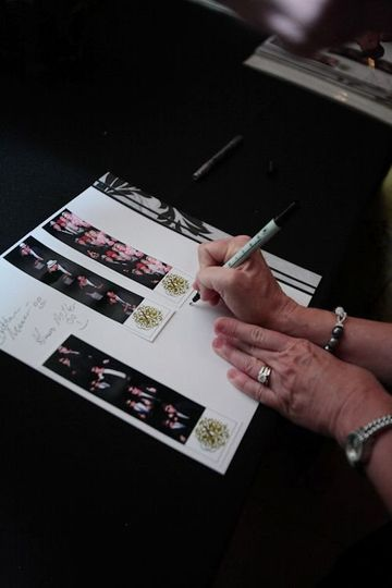 Signing the dedication book