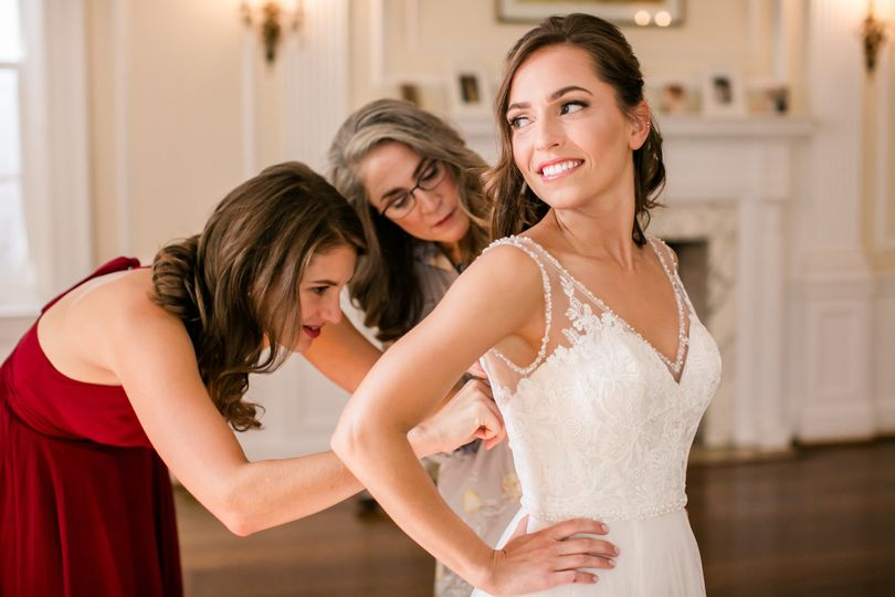Assisting the bride with her gown