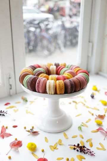 A platter of macarons on each table  adds an elegant touch