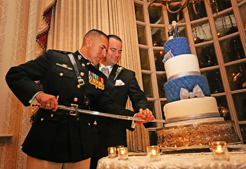 Newlywed couple cake cutting