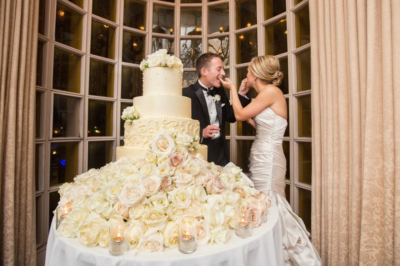 Couple eating wedding cake