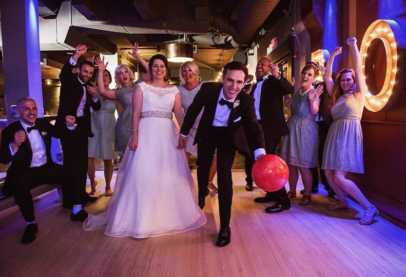 Groom tossing bowling ball