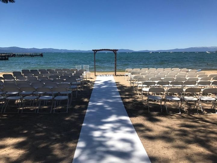 Beach ceremony with wooden arch