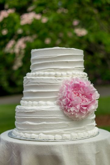 Our signature cake in a 3-tier design with a single peony. Many of our brides opt for fresh flowers...