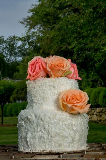 We love our petite Coconut Cake covered in fresh roses. Any flowers or a pretty topper would be...