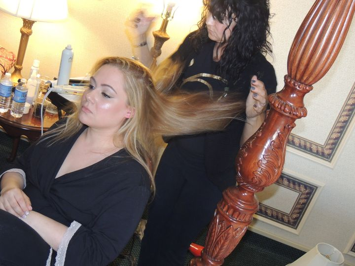 Bride and hairstylist