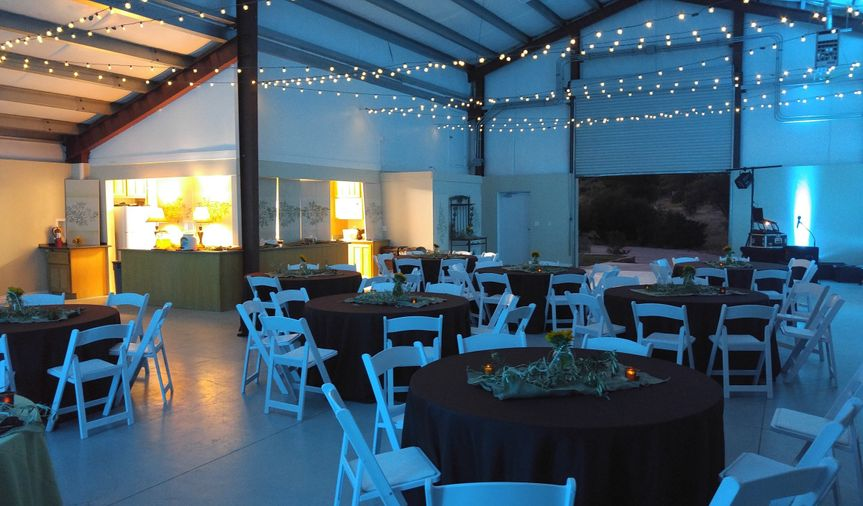 Easy simple uplighting to go with the venues overhead string lighting and the table lamps found on...