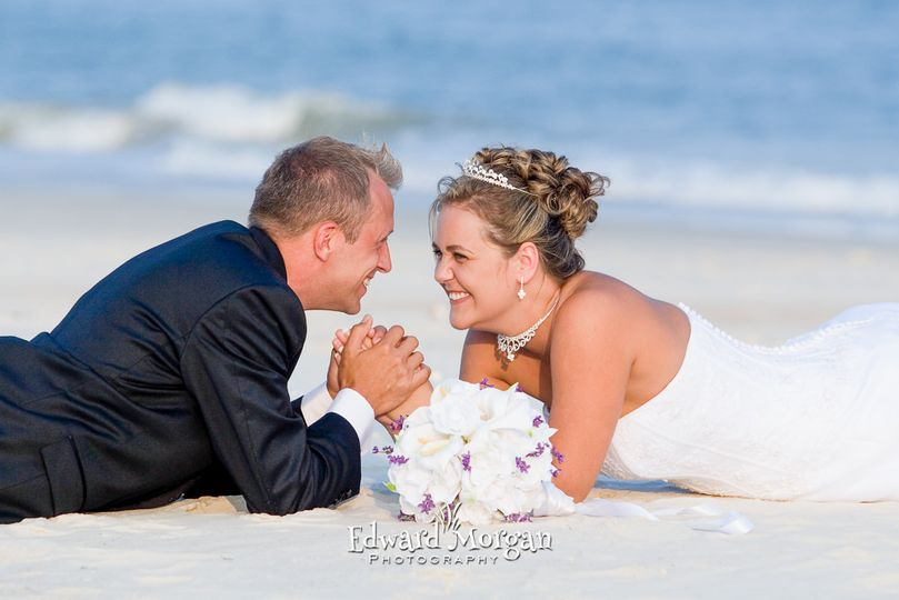 Groom and bride on the sand