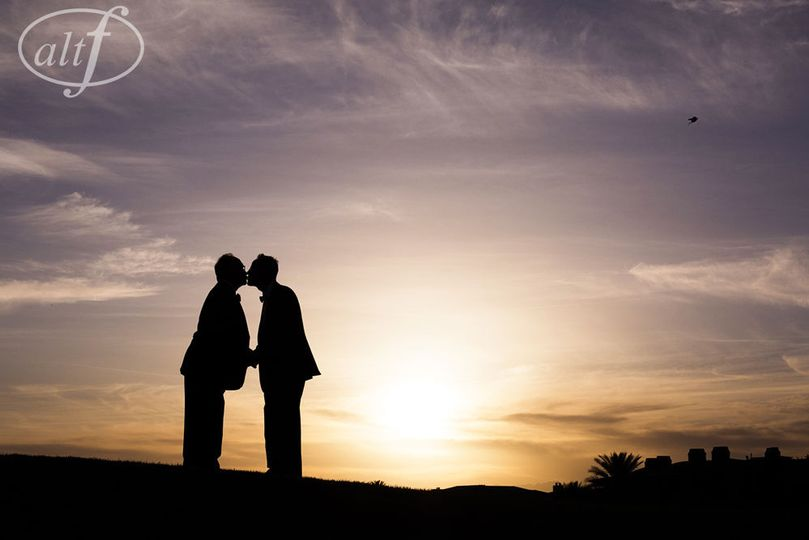 Couple's photo at sunset on the golf course