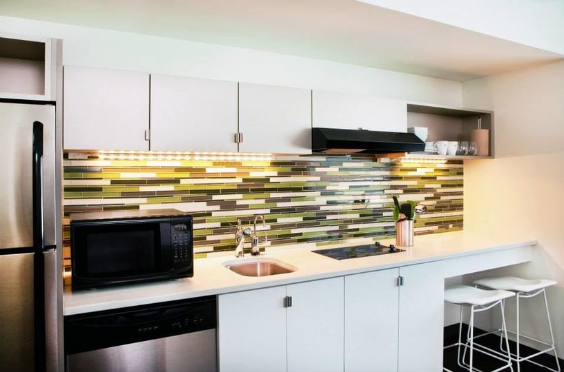 Fully Equipped Kitchenette with full-sized refrigerator, mircrowave, stovetop, dishwasher, and...