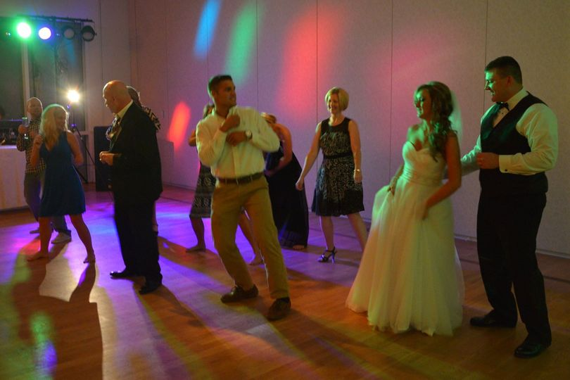 Couple with guests dancing