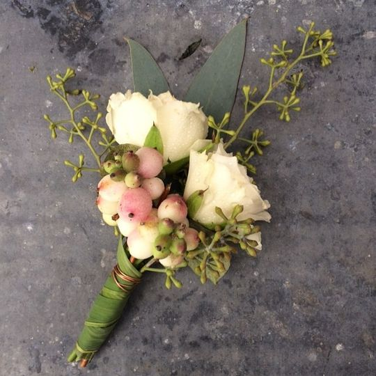 rosebud and berry boutonniere with grass-wrapped stems.