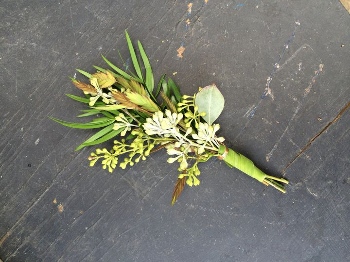 An all green boutonniere with grass-wrapped stems