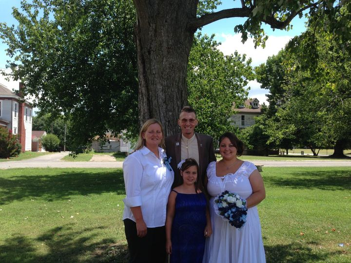With the wedding officiant
