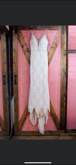 Dressing room door with wedding dress