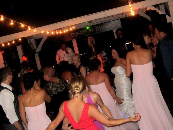 Bride and her bridesmaids dancing