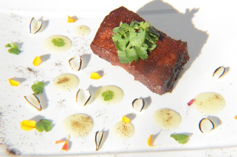 Pork belly al pastor with pineapple gel and onion ash