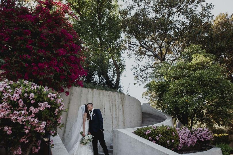 Newlyweds kissing in a garden