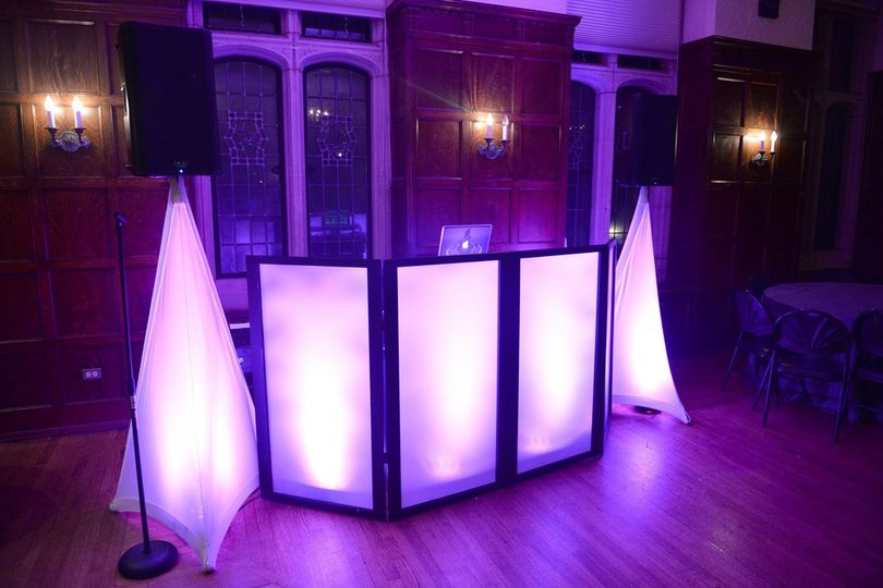 DJ booth with uplighting