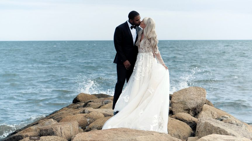 Couple embrace by ocean