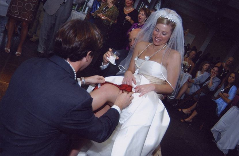 The groom removing the bride garter