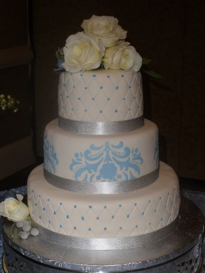 Three tier wedding cake with silver lining